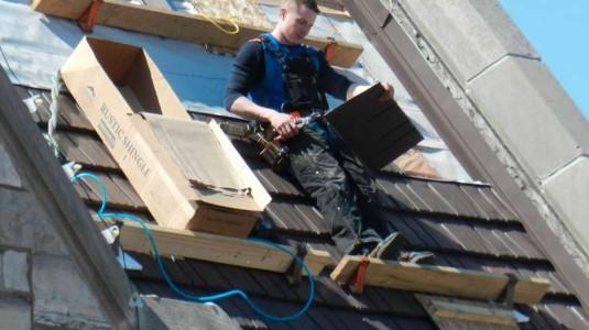 employee-on-roof